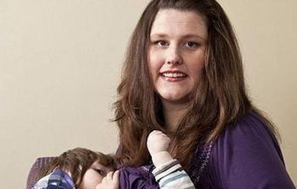 Amanda Hurst breastfeeds her five year old son