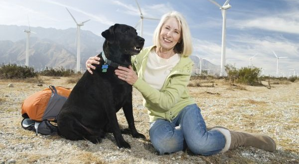 Beautiful Senior Woman Sitting With Pet Dog During Vacation